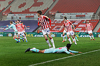 Kyle Naughton of Swansea City lies on the ground after being fouled by Jack Clarke of Stoke City during the Sky Bet Championship match between Stoke City and Swansea City at the Bet365 Stadium, Stoke on Trent, England, UK. Wednesday 03 March 2021