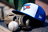 Toronto Blue Jays hat sits on top of a Wilson glove during an Instructional League game against the Philadelphia Phillies on September 17, 2019 at Spectrum Field in Clearwater, Florida.  (Mike Janes/Four Seam Images)
