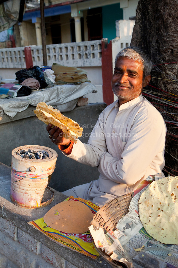India, Rishikesh.  Street Vendor Offering Papadums, a thin, crisp snack made from flour or paste from lentils, chickpeas, rice, or potatoes.