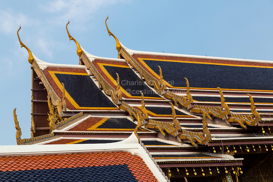 Bangkok, Thailand.  Thai Architecture, showing the chofa, the curling, pointed extensions at each end that represent the Garuda, the vehicle of Vishnu.  Royal Grand Palace Compound.  Wat Phra Kaew, Temple of the Emerald Buddha.