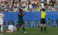 GRENOBLE, FRANCE - JUNE 22: Yellow Card: Desire Oparanozie #9 of the Nigerian National Team issued by Yoshimi Yamashita during a game between Panama and Guyana at Stade des Alpes on June 22, 2019 in Grenoble, France.