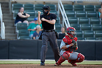 Home plate umpire Evin Johnson makes a strike call during the South Atlantic League game between the Lakewood BlueClaws and the Kannapolis Intimidators at Kannapolis Intimidators Stadium on July 18, 2019 in Kannapolis, North Carolina. The Intimidators defeated the BlueClaws 7-1. (Brian Westerholt/Four Seam Images)