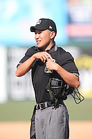 Home plate umpire Takahito Matsuda during the California League game between the Lake Elsinore Storm and the Inland Empire 66'ers at San Manuel Stadium on May 27, 2015 in San Bernardino, California. Lake Elsinore defeated Inland Empire, 12-9. (Larry Goren/Four Seam Images)