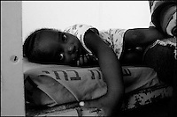 A Sudanese girl is seen in her room at Ktziot prison, August 21, 2007.Sudanese refugees who crossed into Israel illegally are seen in Ktiziot Prison in the Negev Dessert in Israel. About 130 women and children are living in the prison and their future is unclear. Israel said on Sunday it would turn away refugees from Sudan enforcing a policy aimed at halting illegal African migration via Egypt. Photo by Quique Kierszenbaum
