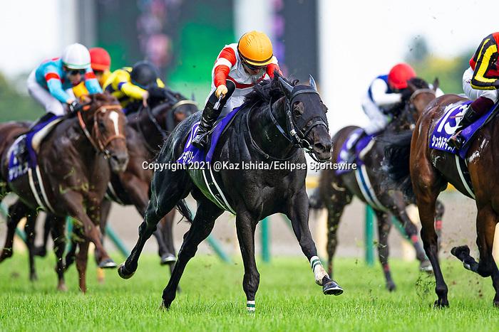FUCHU,JAPAN-JUN 6: Danon Kingly #11,ridden by Yuga Kawada,wins the Yasuda Kinen at Tokyo Racecourse on June 6,2021 in Fuchu,Tokyo,Japan. Kaz Ishida/Eclipse Sportswire/CSM