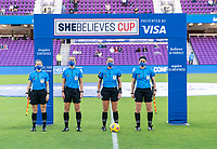 ORLANDO, FL - FEBRUARY 21: Referees Tori Penso, Brooke Mayo, Jennifer Garner and Katja Koroleva line up before a game between Canada and Argentina at Exploria Stadium on February 21, 2021 in Orlando, Florida.
