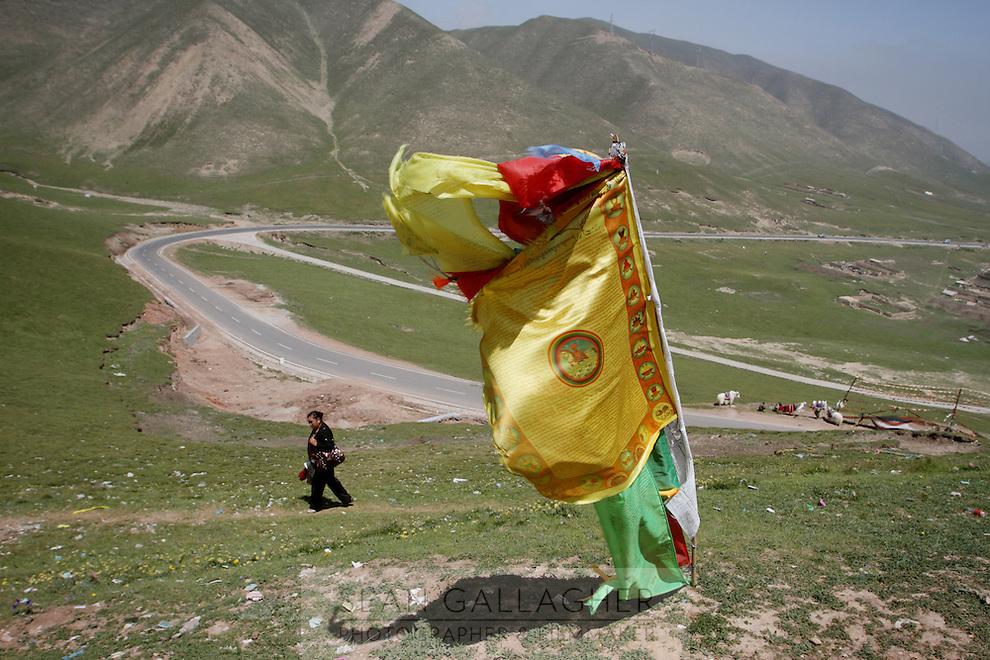 Tibetan flags fly on a hill on the Qinghai-Tibetan Plateau, Qinghai Province. China. 2010