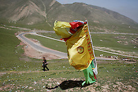 Tibetan flags fly on a hill on the Qinghai-Tibetan Plateau, Qinghai Province. China. 2010