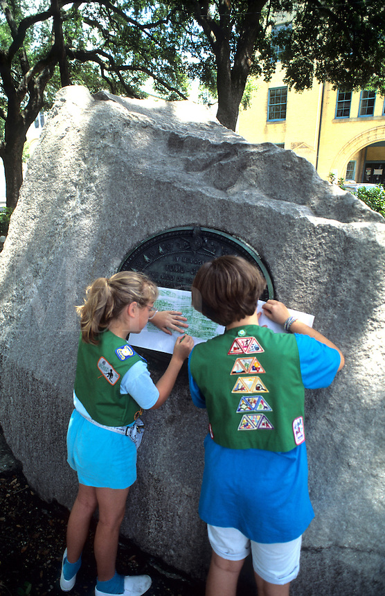 Girl scouts rubbing plaguesin the park, City of Savannah Georgia USA