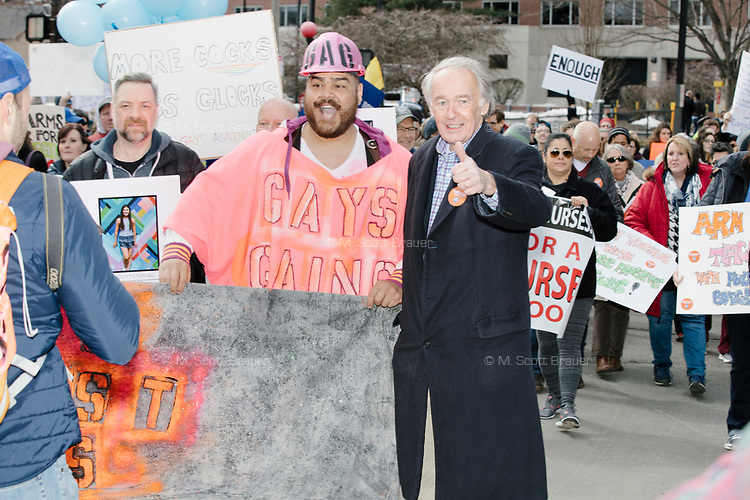 """US Senator Ed Markey poses with members of Gays Against Guns as they take part in the March For Our Lives protest, walking from Roxbury Crossing to Boston Common, in Boston, Massachusetts, USA, on Sat., March 24, 2018, in response to recent school gun violence. Here a woman is holding a sign reading """"Repeal the 2nd Amendment."""""""