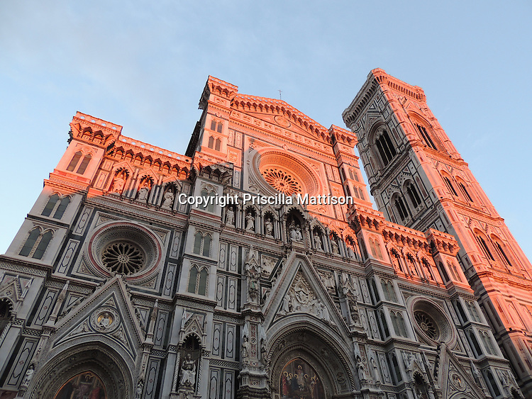 Florence, Italy - October 1, 2012: Rosy light falls on the Florence Cathedral.