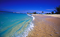 Crystal clear wave laps on white sand beach, North shore, Oahu, Hawaii