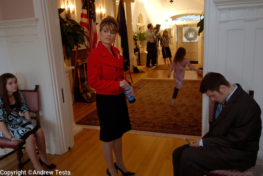 USA. Juneau.13th September 2007.Governor Palin talks to her children Track (right) and Willow (left) as the family prepares for official photographs to be taken at the Governor's  Mansion in Juneau..©Andrew Testa/Panos