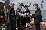 The annual Colchester Opening of the Colne Oyster Fishery, Brightlingsea, Essex. 2021. The annual event takes place on the first Friday in September aboard the Thistle a Thames Barge.  Adrian Pritchard - Chief Executive reads the Proclamation, and with the Mayor  Cllr Robert Davidson drink a Loyal Toast, with gin and gingerbread.  <br /> Paul Lind is the Town Serjeant with Mace.<br /> Jonathan Rochford Deputy Town Serjeant with tray of gin and gingerbread.