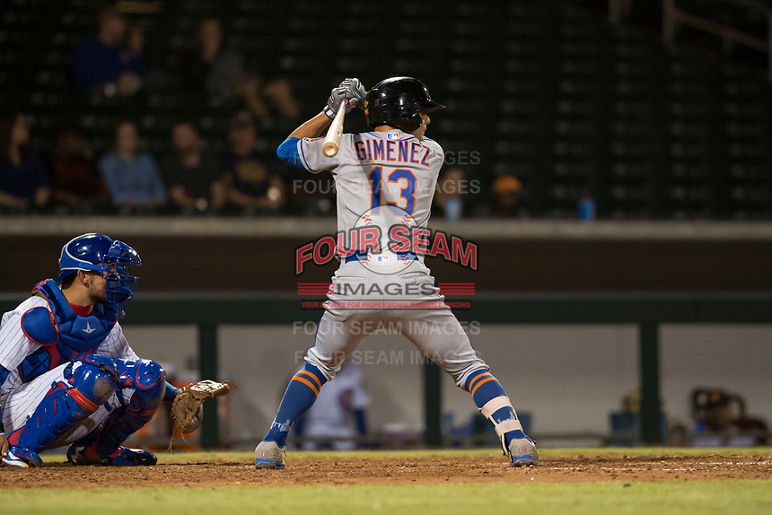 Scottsdale Scorpions shortstop Andres Gimenez (13), of the New York Mets organization, at bat in front of catcher Jhonny Pereda (6) during an Arizona Fall League game against the Mesa Solar Sox at Sloan Park on October 10, 2018 in Mesa, Arizona. Scottsdale defeated Mesa 10-3. (Zachary Lucy/Four Seam Images)