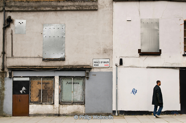 Boarded-up antique shop in Prince of Wales Road, Chalk Farm