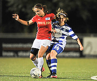 20130906 - OOSTAKKER , BELGIUM : PSV's Danielle van de Donk pictured in a duel with Gent's captain Elke Van de Sompel during the female soccer match between AA Gent Ladies  and PSV / FC Eindhoven Dames , of the third matchday in the BENELEAGUE competition. Friday 06 th September 2013. PHOTO DAVID CATRY