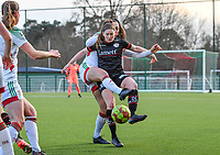 Amber Tysiak (3) of OHL pictured fighting for the ball with Anne-Lore Scherrens (22) of Zulte-Waregem during a female soccer game between Oud Heverlee Leuven and SV Zulte-Waregem on the 16 th matchday of the 2020 - 2021 season of Belgian Womens Super League , sunday 14 th of March 2021  in Heverlee , Belgium . PHOTO SPORTPIX.BE | SPP | DAVID CATRY