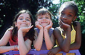Three friends at a Camden Council summer playscheme.