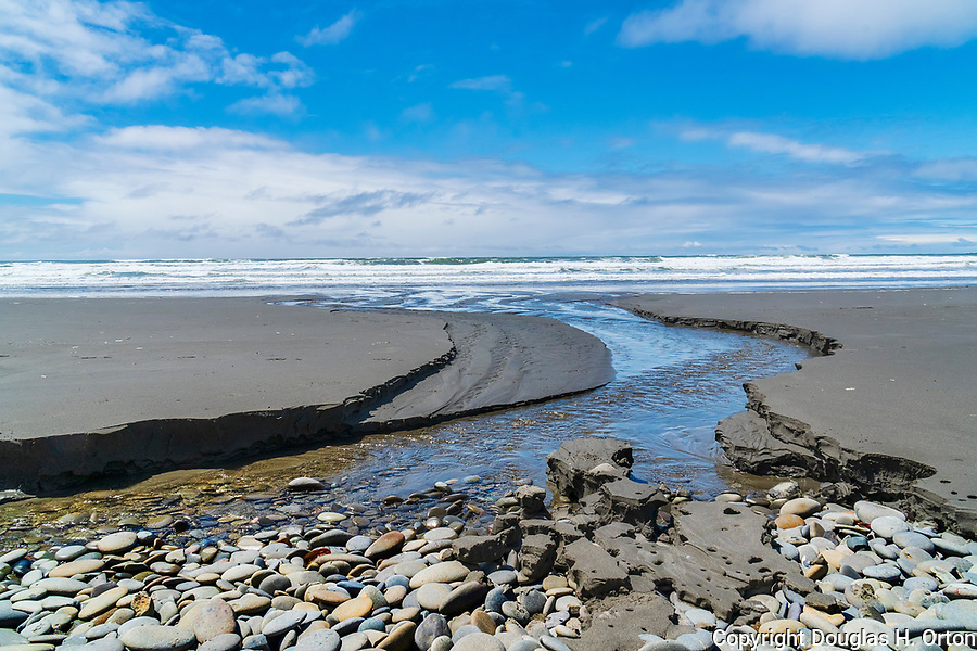 An unnamed creek winds over Kalaloch Beach in Olympic National Park, Washington.  Beaches in the Kalaloch area of Olympic National Park, identified by trail numbers, are remote and wild.  Olympic Peninsula, Olympic Mountains, Olympic National Park, Washington State, USA.
