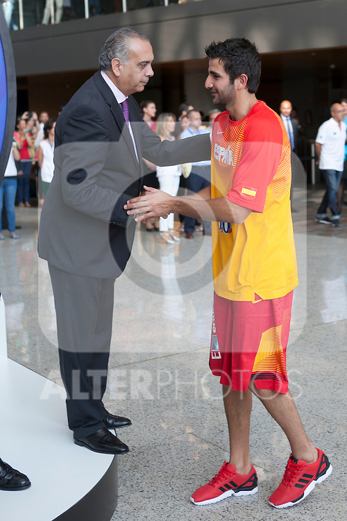 Jose Luis Saez greets Ricky Rubio during the official presentation of Spain´s basketball team for the 2014 Spain Basketball Championship in Madrid, Spain. July 24, 2014. (ALTERPHOTOS/Victor Blanco)