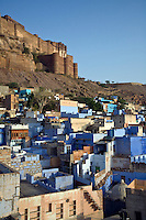 DAWN illuminates the MEHERANGARH FORT on the hill above JODHPUR also known as the BLUE CITY - RAJASTHAN, INDIA