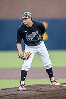 Maryland Terrapins pitcher Grant Burleson (14) looks to his catcher for the sign against the Michigan Wolverines on April 13, 2018 in a Big Ten NCAA baseball game at Ray Fisher Stadium in Ann Arbor, Michigan. Michigan defeated Maryland 10-4. (Andrew Woolley/Four Seam Images)
