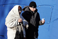 Una donna e un uomo nella tendopoli allestita per accogliere gli sfollati, in piazza d'Armi, all'Aquila, in Abruzzo, 8  aprile 2009, dopo il terremoto che ha colpito la regione..A woman and a man walk in a tent-camp set up by the civil protection agency, in L'Aquila, central Italy, 8 april 2009, to put up survivors of the earthquake that hit the region Abruzzo..UPDATE IMAGES PRESS/Riccardo De Luca