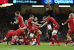 Wales scrum half Rhys Webb clears the ball from the back of the breakdown.<br /> Dove men Series 2014<br /> Wales v New Zealand<br /> 22.11.14<br /> ©Steve Pope -SPORTINGWALES