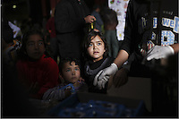 Pictured: Young children gather to be handed out food Monday 07 March 2016<br /> Re: Migrants have been gathering at the port of Piraeus, near Athens, Greece.