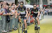 "Bernhard 'Bernie' Eisel (AUT/Dimension Data) hanging on  Jaco Venter's (ZAF/Dimension Data) Qubeka bike<br /> <br /> ""Le Grand Départ"" <br /> 104th Tour de France 2017 <br /> Team Presentation in Düsseldorf/Germany"