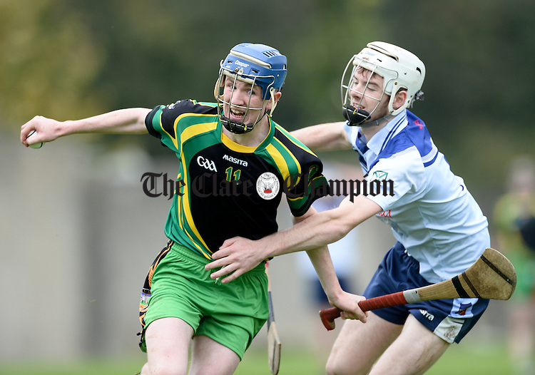 Conor Henry of Bodyke/O Callaghan's Mills in action against Diarmuid Mc Namara of Scariff /Ogonnelloe  during the Minor B hurling final at Newmarket on Fergus. Photograph by John Kelly.