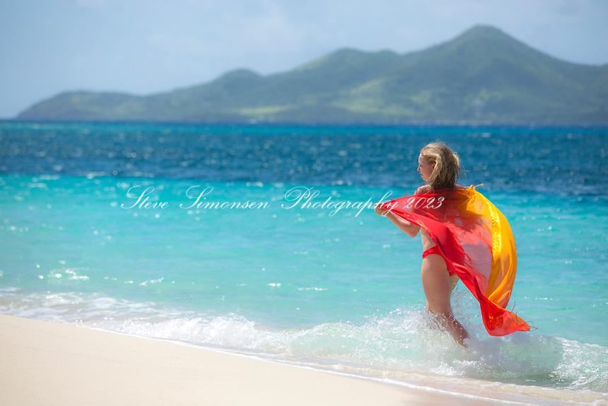 Model Alex Krasny on the beach at Buck Island<br /> St. Croix<br /> US Virgin Islands
