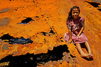The Images from the Book Journey through Color and Time, Chuuk,Truk Lagoon,Micronesia, Little Girl sitting on an old WWII landing craft