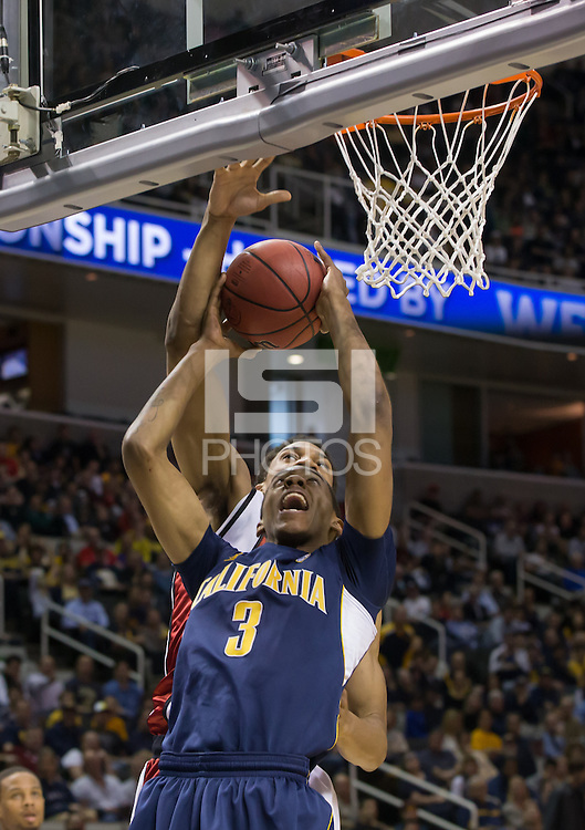March 21st, 2013: California's Tyrone Wallace shoots for the basket but was blocked by UNLV defender during a game at HP Pavilion, San Jose, California. California defeated UNLV 64 - 61