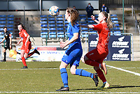 forward Hanne Merkelbach (25) of KRC Genk battles for the ball with Magali Dinon (6) of Woluwe during a female soccer game between FC Femina White Star Woluwe and KRC Genk on the 17 th matchday of the 2020 - 2021 season of Belgian Scooore Womens Super League , Saturday 20 th of March 2021  in Woluwe , Belgium . PHOTO SPORTPIX.BE | SPP | JILL DELSAUX