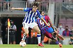 FC Barcelona's Memphis Depay (r) and Real Sociedad's Aritz Elustondo during La Liga match. August 15, 2021. (ALTERPHOTOS/Acero)