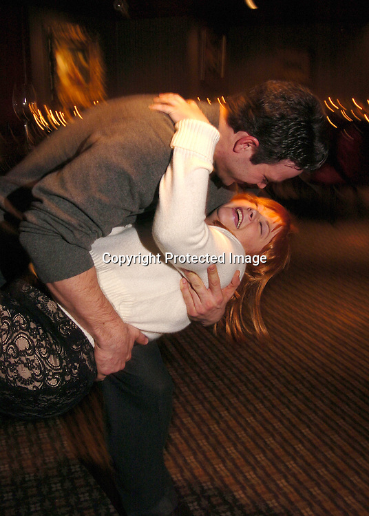 """Kathy Brier and Nathaniel Marston ..at a performance of """"Hairspray"""" on December 18, 2003 at the Neil Simon Theatre and also at a party at Ruth's Chris..Steakhouse in New York City.  Nathaniel Marston and Timothy Adams gave Kathy flowers at the curtain call. Photo by Robin Platzer, Twin Images"""
