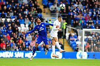 Josh Murphy of Cardiff City vies for possession with Matthew Lowton of Burnley during the Premier League match between Cardiff City and Burnley at Cardiff City Stadium in Cardiff, Wales, UK. Sunday 30 September 2018