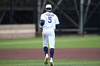Dallas Jesuit Rangers shortstop Jordan Lawlar (5) jogs to his position during a game against the Richardson Eagles on April 24, 2021 at Wright Field in Dallas, Texas.  (Ken Murphy/Four Seam Images)
