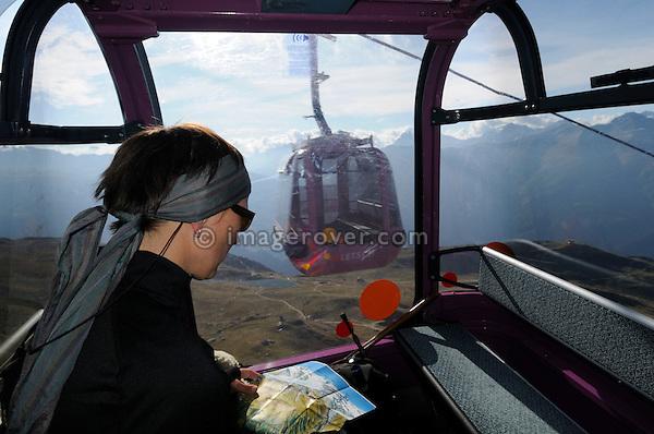 Switzerland, Valais, Western Europe, Aletsch Glacier region (UNESCO world heritage site). Female tourist on the Aerial tramway from Bettmeralp to  Bettmerhorn. --- Model release available.