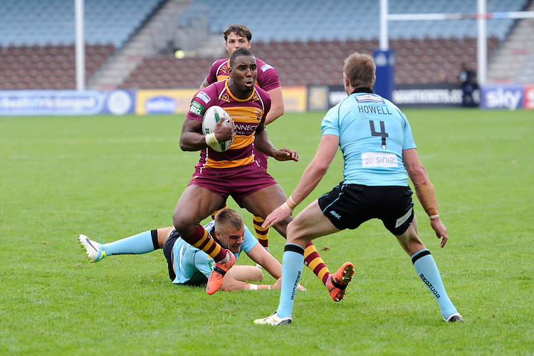 Michael Lawrence of Huddersfield Giants faces up to David Howell of London Broncos during the Super League match between Huddersfield Giants and London Broncos at The Twickenham Stoop on Saturday 17th August 2013 (Photo by Rob Munro)