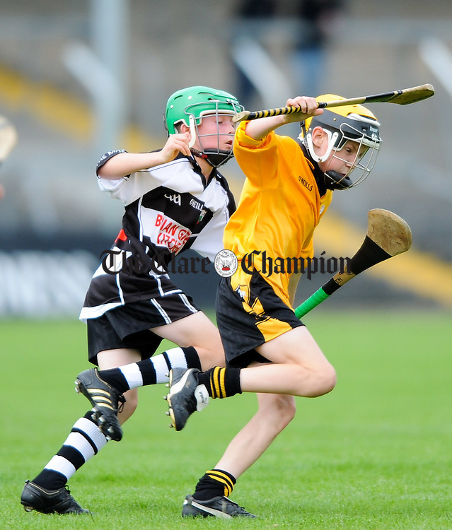 Stephan Barry of Clarecastle in action against Paraic Campbell of Clonlara during their U-12A Hurling county Final at Cusack Park. Photograph by John Kelly.