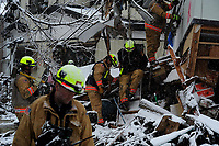 Members of the Fairfax County, Va. Task Force 1 Urban Search and Rescue search structures and debris on March 16, 2011 in Kamaishi, Japan. A 9.0 earthquake hit Japan on March 11, 2011 that caused a tsunami that destroyed anything in its path.