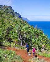 An older couple hikes the Kalalau Trail near Hanakapi'ai Beach on Kaua'i.