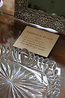 Detail of a crystal dish and mirror on a dressing table