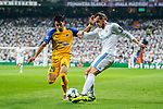 Gareth Bale (r) of Real Madrid fights for the ball with Praxitellis Vouros of APOEL FC during the UEFA Champions League 2017-18 match between Real Madrid and APOEL FC at Estadio Santiago Bernabeu on 13 September 2017 in Madrid, Spain. Photo by Diego Gonzalez / Power Sport Images