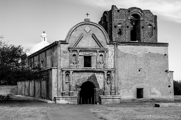Black and white image of the facade at the Tumacacori mission