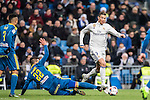 Cristiano Ronaldo (r) of Real Madrid vies for the ball with Gustavo Daniel Cabral of RC Celta de Vigo during their Copa del Rey 2016-17 Quarter-final match between Real Madrid and Celta de Vigo at the Santiago Bernabéu Stadium on 18 January 2017 in Madrid, Spain. Photo by Diego Gonzalez Souto / Power Sport Images