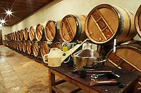 Topping up equipment. Oak barrel aging and fermentation cellar. Clos de l'Obac, Costers del Siurana, Gratallops, Priorato, Catalonia, Spain.